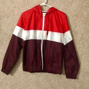 red and maroon windbreaker